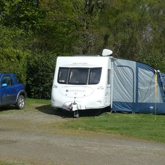 caravan and blue family car