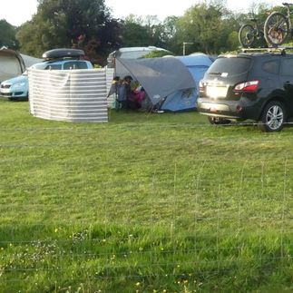 campsite and car park next to tents